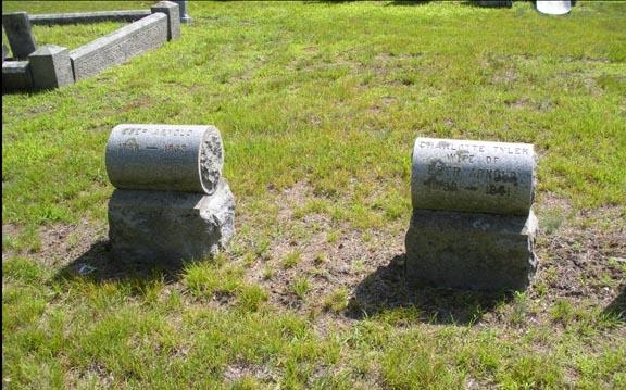 Unusual cylinder-shaped headstones