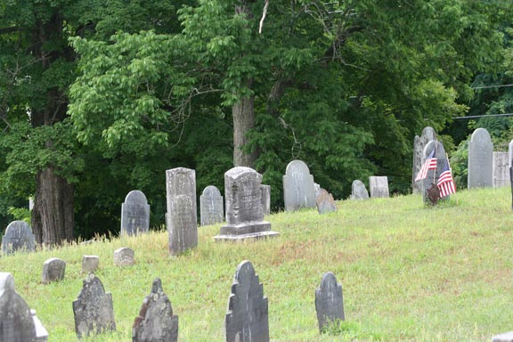 More styles of headstones on a hill