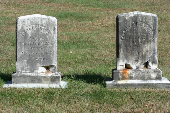2 headstones decaying from the bottom