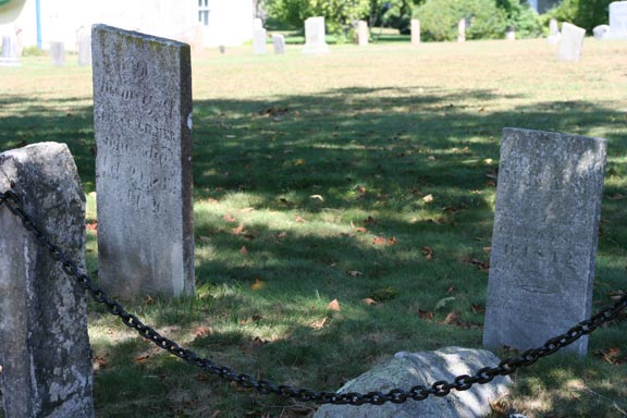 2 headstones right in front, note the rock