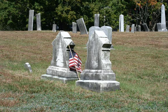 2 unique-styled headstones