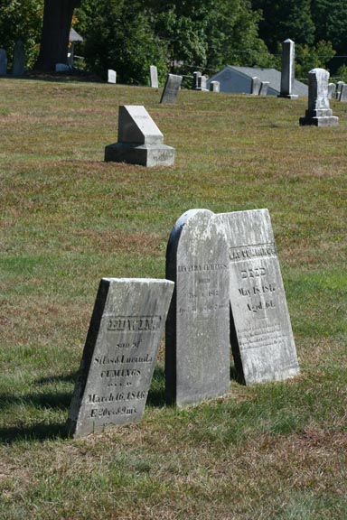 3 headstones leaning in 3 different directions