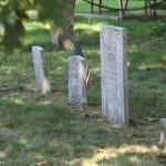 4 headstones of varying heights