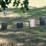 4 tiny headstones