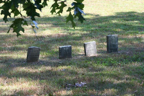 4 tiny headstones