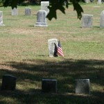 A street view of some tiny headstones