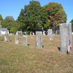 Approaching a neat row of headstones