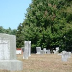 Headstones show the weathering from being out in the open