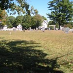 View from the street shows most graves set in the back