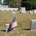 2 small weathered headstones