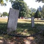 2 very weathered headstones